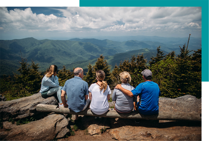 family hiking to lookout point representing active stages of retirement